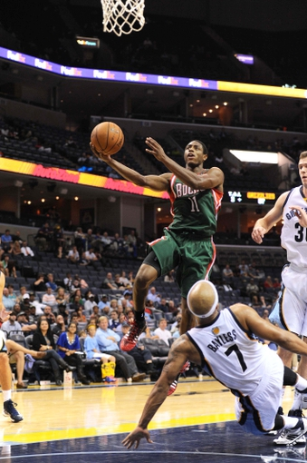 Oct 15, 2013; Memphis, TN, USA; Milwaukee Bucks point guard Brandon Knight (11) lays the ball up during the fourth quarter against the Memphis Grizzlies at FedExForum. Memphis Grizzlies defeat Milwaukee Bucks 102 - 99 Mandatory Credit: Justin Ford-USA TODAY Sports