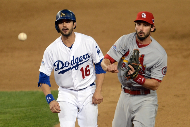 October 15, 2013; Los Angeles, CA, USA; St. Louis Cardinals second baseman Matt Carpenter (13) throws to first after tagging out Los Angeles Dodgers center fielder Andre Ethier (16) in the ninth inning in game four of the National League Championship Series baseball game at Dodger Stadium. Mandatory Credit: Jayne Kamin-Oncea-USA TODAY Sports