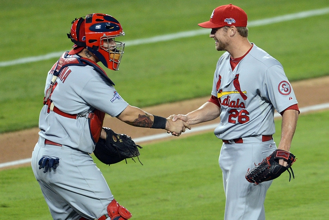 October 15, 2013; Los Angeles, CA, USA; St. Louis Cardinals catcher Yadier Molina (4) and relief pitcher Trevor Rosenthal (26) celebrate the 4-2 victory against the Los Angeles Dodgers  in game four of the National League Championship Series baseball game at Dodger Stadium. Mandatory Credit: Jayne Kamin-Oncea-USA TODAY Sports
