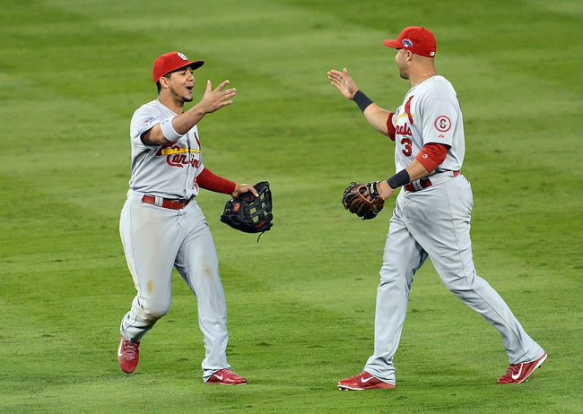 October 15, 2013; Los Angeles, CA, USA; St. Louis Cardinals center fielder Jon Jay (19) and right fielder Carlos Beltran (3) celebrate the 4-2 victory against the Los Angeles Dodgers  in game four of the National League Championship Series baseball game at Dodger Stadium. Mandatory Credit: Jayne Kamin-Oncea-USA TODAY Sports
