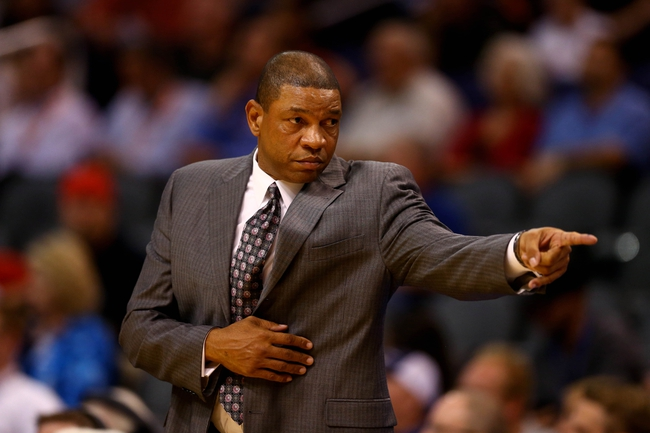 Oct 15, 2013; Phoenix, AZ, USA; Los Angeles Clippers head coach Doc Rivers reacts against the Phoenix Suns at US Airways Center. Mandatory Credit: Mark J. Rebilas-USA TODAY Sports