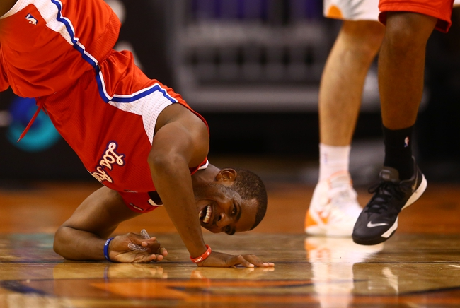 Oct 15, 2013; Phoenix, AZ, USA; Los Angeles Clippers guard Chris Paul (3) reacts as he rolls over against the Phoenix Suns at US Airways Center. Mandatory Credit: Mark J. Rebilas-USA TODAY Sports