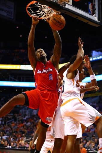 Oct 15, 2013; Phoenix, AZ, USA; Los Angeles Clippers center DeAndre Jordan (6) dunks the ball against the Phoenix Suns at US Airways Center. Mandatory Credit: Mark J. Rebilas-USA TODAY Sports