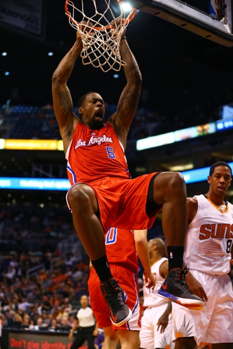 Oct 15, 2013; Phoenix, AZ, USA; Los Angeles Clippers center DeAndre Jordan (6) reacts after dunking the ball against the Phoenix Suns at US Airways Center. Mandatory Credit: Mark J. Rebilas-USA TODAY Sports