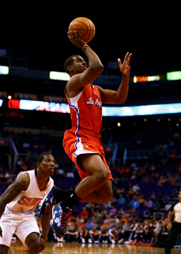 Oct 15, 2013; Phoenix, AZ, USA; Los Angeles Clippers guard Chris Paul takes a shot against the Phoenix Suns at US Airways Center. Mandatory Credit: Mark J. Rebilas-USA TODAY Sports