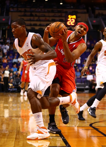 Oct 15, 2013; Phoenix, AZ, USA; Los Angeles Clippers forward Jared Dudley (right) drives to the basket against Phoenix Suns guard Eric Bledsoe at US Airways Center. Mandatory Credit: Mark J. Rebilas-USA TODAY Sports