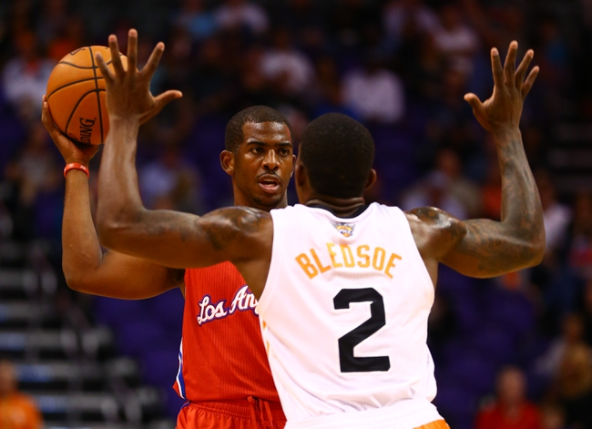 Oct 15, 2013; Phoenix, AZ, USA; Los Angeles Clippers guard Chris Paul (left) controls the ball against Phoenix Suns guard Eric Bledose at US Airways Center. Mandatory Credit: Mark J. Rebilas-USA TODAY Sports