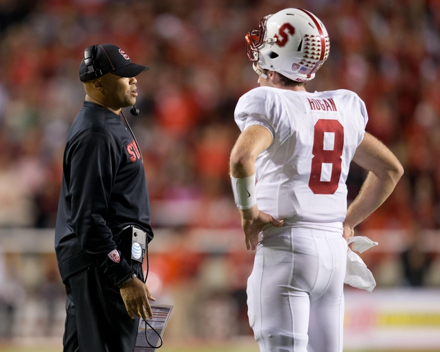Oct 12, 2013; Salt Lake City, UT, USA; Stanford Cardinal head coach David Shaw talks with quarterback Kevin Hogan (8) during the second half against the Utah Utes at Rice-Eccles Stadium. Utah defeated Stanford 27-21. Mandatory Credit: Russ Isabella-USA TODAY Sports