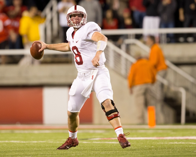 Oct 12, 2013; Salt Lake City, UT, USA; Stanford Cardinal quarterback Kevin Hogan (8) passes the ball during the second half against the Utah Utes at Rice-Eccles Stadium. Utah defeated Stanford 27-21. Mandatory Credit: Russ Isabella-USA TODAY Sports