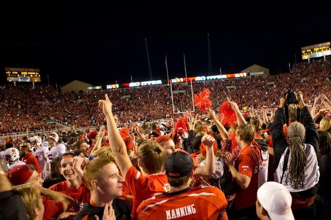 Oct 12, 2013; Salt Lake City, UT, USA; Utah Utes fans celebrate a 27-21 victory over the Stanford Cardinal at Rice-Eccles Stadium. Mandatory Credit: Russ Isabella-USA TODAY Sports