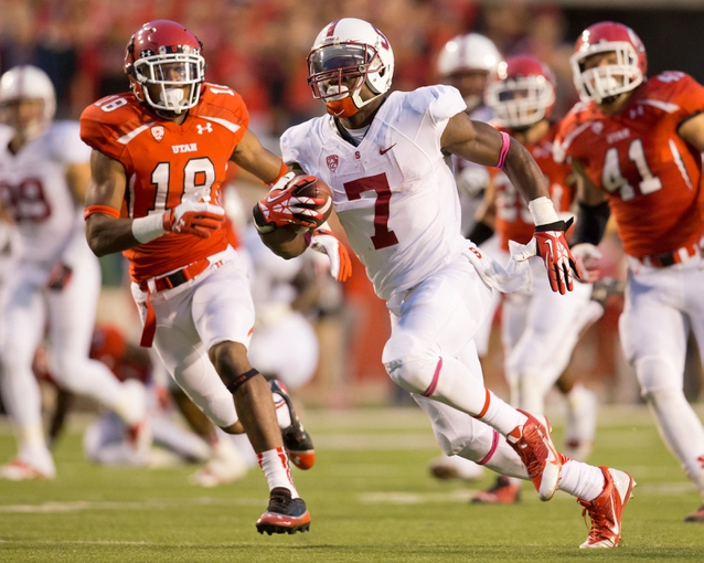 Oct 12, 2013; Salt Lake City, UT, USA; Stanford Cardinal wide receiver Ty Montgomery (7) runs after a reception during the second half against the Utah Utes at Rice-Eccles Stadium. Utah defeated Stanford 27-21. Mandatory Credit: Russ Isabella-USA TODAY Sports