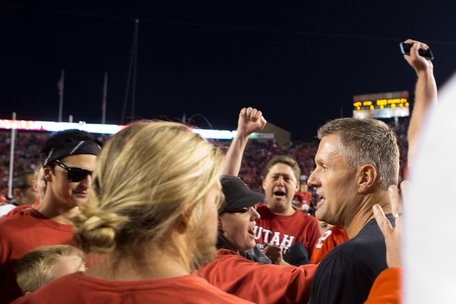 Oct 12, 2013; Salt Lake City, UT, USA; Utah Utes head coach Kyle Whittingham (far right) following a 27-21 victory  over the Stanford Cardinal at Rice-Eccles Stadium. Mandatory Credit: Russ Isabella-USA TODAY Sports