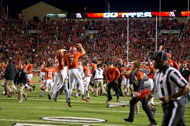 Oct 12, 2013; Salt Lake City, UT, USA; Utah Utes quarterback Travis Wilson (7) and punter Tom Hackett (33) join teammates and fans in celebrating a 27-21 victory over the Stanford Cardinal at Rice-Eccles Stadium. Mandatory Credit: Russ Isabella-USA TODAY Sports