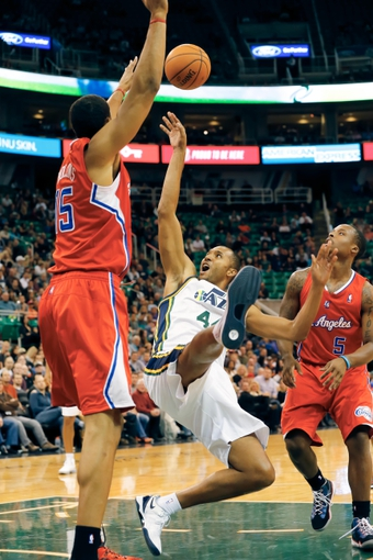 Oct 12, 2013; Salt Lake City, UT, USA; Utah Jazz power forward Brian Cook (44) shoots the ball against Los Angeles Clippers center Ryan Hollins (15) during the fourth quarter at EnergySolutions Arena. The Los Angeles Clippers won 106-74.  Mandatory Credit: Chris Nicoll-USA TODAY Sports