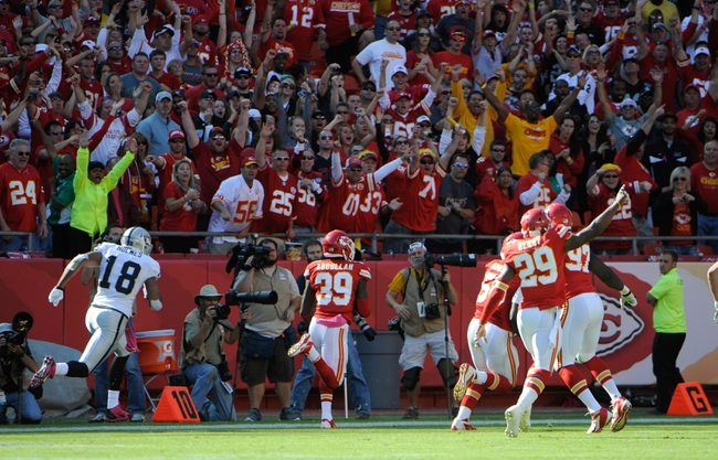 Oct 13, 2013; Kansas City, MO, USA; Kansas City Chiefs defensive back Husain Abdullah (39) returns an interception for a touchdown against the Oakland Raiders in the second half at Arrowhead Stadium. Kansas City won the game 24-7. Mandatory Credit: John Rieger-USA TODAY Sports