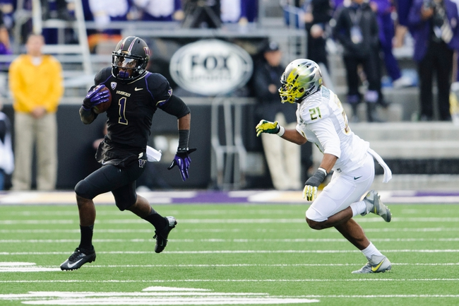 Oct 12, 2013; Seattle, WA, USA; Washington Huskies wide receiver John Ross (1) runs with the ball while being chased by Oregon Ducks cornerback Avery Patterson (21) during the game at Husky Stadium. Oregon defeated Washington 45-24. Mandatory Credit: Steven Bisig-USA TODAY Sports