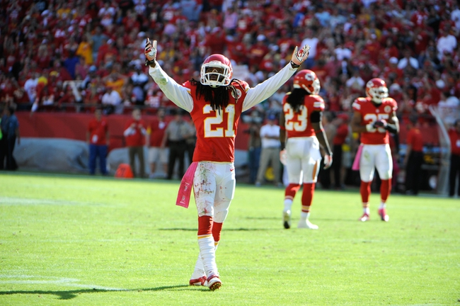 Oct 13, 2013; Kansas City, MO, USA; Kansas City Chiefs cornerback Dunta Robinson (21) tries to excite the fans against the Oakland Raiders in the second half at Arrowhead Stadium. Kansas City won the game 24-7. Mandatory Credit: John Rieger-USA TODAY Sports