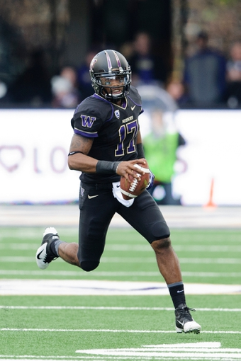 Oct 12, 2013; Seattle, WA, USA; Washington Huskies quarterback Keith Price (17) holds onto the ball during the game against the Oregon Ducks at Husky Stadium. Oregon defeated Washington 45-24. Mandatory Credit: Steven Bisig-USA TODAY Sports
