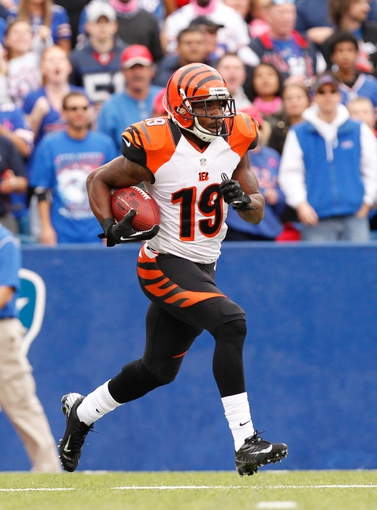 Oct 13, 2013; Orchard Park, NY, USA; Cincinnati Bengals wide receiver Brandon Tate (19) runs against the Buffalo Bills during the second half at Ralph Wilson Stadium. Bengals beat the Bills 27-24 in overtime. Mandatory Credit: Kevin Hoffman-USA TODAY Sports