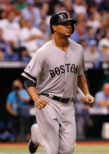 Oct 7, 2013; St. Petersburg, FL, USA; Boston Red Sox shortstop Xander Bogaerts (72) runs to first to pitch run against the Tampa Bay Rays of game three of the American League divisional series at Tropicana Field. Tampa Bay Rays defeated the Boston Red Sox 5-4. Mandatory Credit: Kim Klement-USA TODAY Sports
