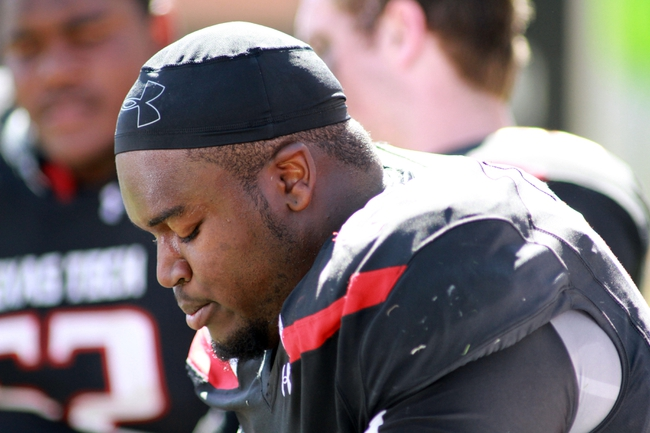 Oct 12, 2013; Lubbock, TX, USA; Texas Tech Red Raiders offensive lineman James Polk (63) on the sidelines during the game with the Iowa State Cyclones at Jones AT&T Stadium. Mandatory Credit: Michael C. Johnson-USA TODAY Sports