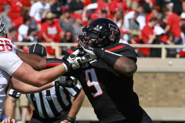 Oct 12, 2013; Lubbock, TX, USA; Texas Tech Red Raiders linebacker Branden Jackson (9) in the second half in the game with the Iowa State Cyclones at Jones AT&T Stadium. Mandatory Credit: Michael C. Johnson-USA TODAY Sports