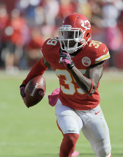 Oct 13, 2013; Kansas City, MO, USA; Kansas City Chiefs defensive back Husain Abdullah (39) runs the ball after intercepting a pass during the second half against the Oakland Raiders at Arrowhead Stadium. The Chiefs won 24-7. Mandatory Credit: Denny Medley-USA TODAY Sports