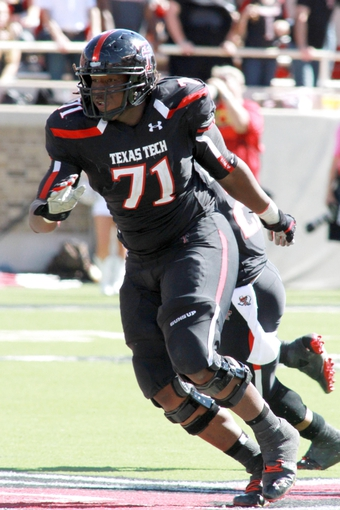 Oct 12, 2013; Lubbock, TX, USA; Texas Tech Red Raiders offensive lineman Rashad Fortenberry (71) in the second half in the game with the Iowa State Cyclones at Jones AT&T Stadium. Mandatory Credit: Michael C. Johnson-USA TODAY Sports