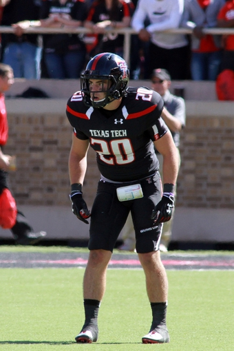 Oct 12, 2013; Lubbock, TX, USA; Texas Tech Red Raiders defensive back Tanner Jacobson (20) in the second half in the game against the Iowa State Cyclones at Jones AT&T Stadium. Mandatory Credit: Michael C. Johnson-USA TODAY Sports