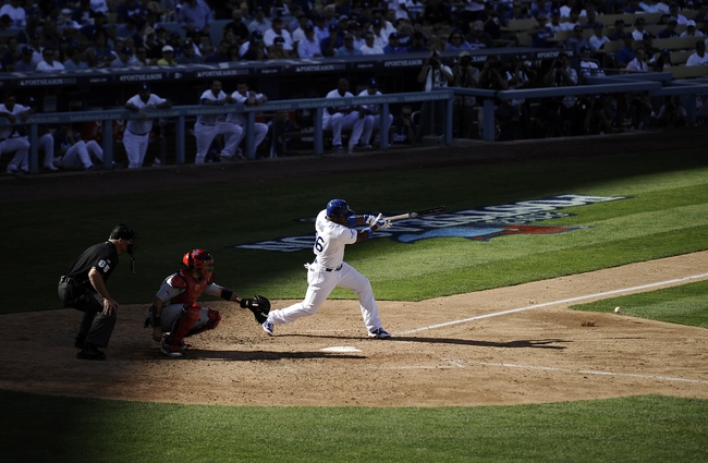 October 16, 2013; Los Angeles, CA, USA; Los Angeles Dodgers right fielder Yasiel Puig (66) grounds out during the sixth inning against the St. Louis Cardinals in game five of the National League Championship Series baseball game at Dodger Stadium. Mandatory Credit: Robert Hanashiro-USA TODAY Sports