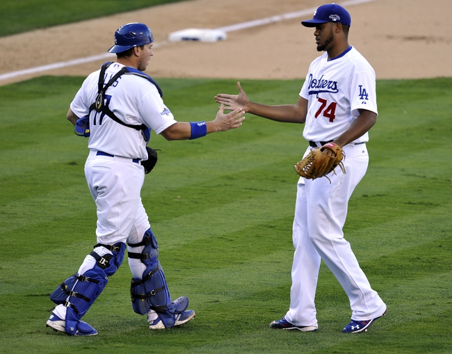 October 16, 2013; Los Angeles, CA, USA; Los Angeles Dodgers relief pitcher Kenley Jansen (74) and catcher A.J. Ellis (17) celebrate the 6-4 victory against the St. Louis Cardinals in game five of the National League Championship Series baseball game at Dodger Stadium. Mandatory Credit: Robert Hanashiro-USA TODAY Sports