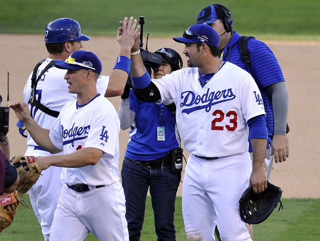 October 16, 2013; Los Angeles, CA, USA; Los Angeles Dodgers first baseman Adrian Gonzalez (23) celebrates the 6-4 victory against the St. Louis Cardinals in game five of the National League Championship Series baseball game at Dodger Stadium. Mandatory Credit: Robert Hanashiro-USA TODAY Sports