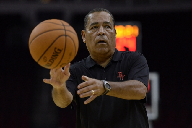 Oct 16, 2013; Houston, TX, USA; Houston Rockets assistant coach Kelvin Sampson passes the basketball before the game against the Orlando Magic at Toyota Center. Mandatory Credit: Thomas Campbell-USA TODAY Sports