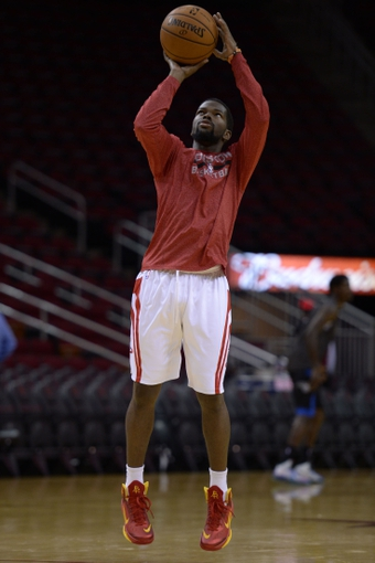 Oct 16, 2013; Houston, TX, USA; Houston Rockets point guard Aaron Brooks (0) warms up before the game against the Orlando Magic at Toyota Center. Mandatory Credit: Thomas Campbell-USA TODAY Sports