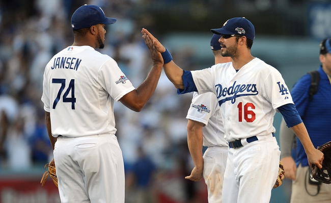 October 16, 2013; Los Angeles, CA, USA; Los Angeles Dodgers relief pitcher Kenley Jansen (74) and center fielder Andre Ethier (16) celebrate the 6-4 victory against the St. Louis Cardinals in game five of the National League Championship Series baseball game at Dodger Stadium. Mandatory Credit: Jayne Kamin-Oncea-USA TODAY Sports