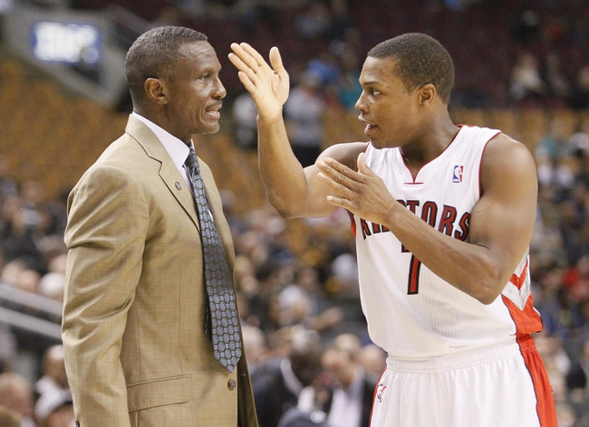 Oct 16, 2013; Toronto, Ontario, CAN; Toronto Raptors guard Kyle Lowry (7) talks to head coach Dwane Casey during the first half against the Boston Celtics at Air Canada Centre. Mandatory Credit: John E. Sokolowski-USA TODAY Sports