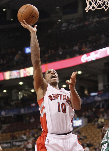Oct 16, 2013; Toronto, Ontario, CAN; Toronto Raptors guard DeMar DeRozan (10) goes up to make a basket against the Boston Celtics during the first half at Air Canada Centre. Mandatory Credit: John E. Sokolowski-USA TODAY Sports