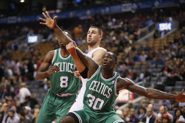 Oct 16, 2013; Toronto, Ontario, CAN; Boston Celtics forward Brandon Bass (30) and forward Jeff Green (8) defend against Toronto Raptors center Jonas Valanciunas (17) during the first half at Air Canada Centre. Mandatory Credit: John E. Sokolowski-USA TODAY Sports