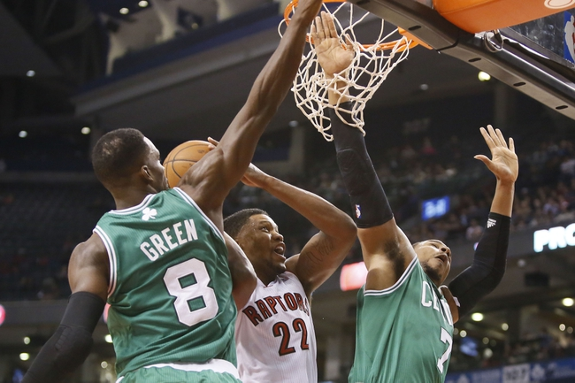 Oct 16, 2013; Toronto, Ontario, CAN; Toronto Raptors forward Rudy Gay (22) goes up to make a shot as Boston Celtics forward Jeff Green (8) and forward Jared Sullinger (7) defend during the first half at Air Canada Centre. Mandatory Credit: John E. Sokolowski-USA TODAY Sports