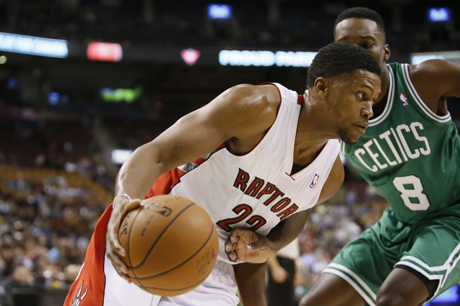 Oct 16, 2013; Toronto, Ontario, CAN; Toronto Raptors forward Rudy Gay (22) drives to the net against Boston Celtics forward Jeff Green (8) during the first half at Air Canada Centre. Mandatory Credit: John E. Sokolowski-USA TODAY Sports