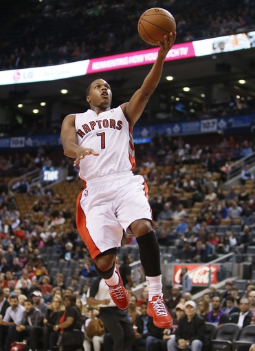Oct 16, 2013; Toronto, Ontario, CAN; Toronto Raptors guard Kyle Lowry (7) goes up to make a basket against the Boston Celtics during the first half at Air Canada Centre. Mandatory Credit: John E. Sokolowski-USA TODAY Sports
