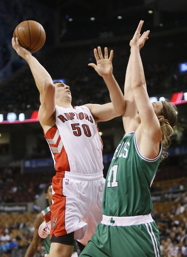 Oct 16, 2013; Toronto, Ontario, CAN; Toronto Raptors forward Tyler Hansbrough (50) goes up to make a basket as Boston Celtics forward Kelly Olynyk (41) defends during the first half at Air Canada Centre. Mandatory Credit: John E. Sokolowski-USA TODAY Sports