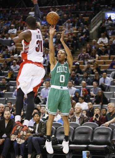 Oct 16, 2013; Toronto, Ontario, CAN; Boston Celtics guard Avery Bradley (0) shoots the ball as Toronto Raptors guard Terrence Ross (31) defends during the second half at Air Canada Centre. Toronto defeated Boston 99-97. Mandatory Credit: John E. Sokolowski-USA TODAY Sports