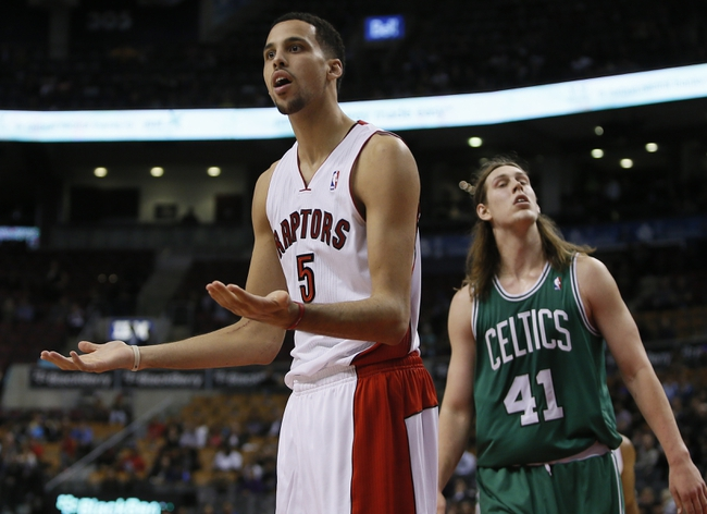 Oct 16, 2013; Toronto, Ontario, CAN; Toronto Raptors forward Austin Daye (5) reacts to a call as Boston Celtics forward Kelly Olynyk (41) looks on during the second half at Air Canada Centre. Toronto defeated Boston 99-97. Mandatory Credit: John E. Sokolowski-USA TODAY Sports