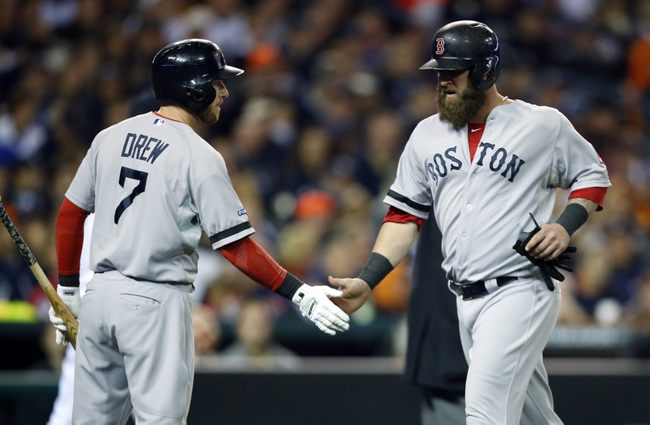 Oct 16, 2013; Detroit, MI, USA; Boston Red Sox first baseman Mike Napoli (12) is congratulated by shortstop Stephen Drew (7) after scoring against the Detroit Tigers during the fifth inning in game four of the American League Championship Series baseball game at Comerica Park. Mandatory Credit: Rick Osentoski-USA TODAY Sports