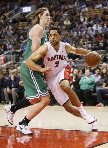 Oct 16, 2013; Toronto, Ontario, CAN; Toronto Raptors forward Landry Fields (2) drives to the basket as Boston Celtics forward Kelly Olynyk (41) defends at Air Canada Centre. Toronto defeated Boston 99-97. Mandatory Credit: John E. Sokolowski-USA TODAY Sports