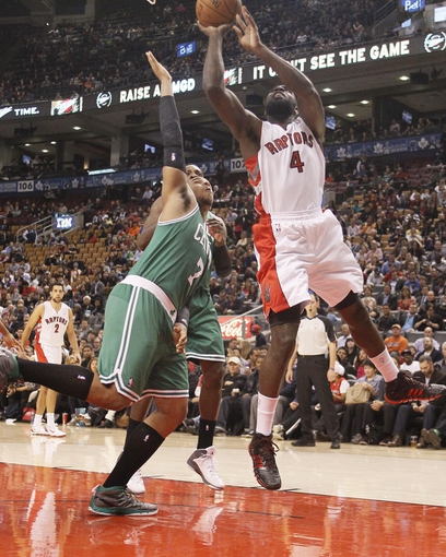 Oct 16, 2013; Toronto, Ontario, CAN; Toronto Raptors forward Quincy Acy (4) goes up for a basket as Boston Celtics forward Jared Sullinger (7) defends at Air Canada Centre. Toronto defeated Boston 99-97. Mandatory Credit: John E. Sokolowski-USA TODAY Sports