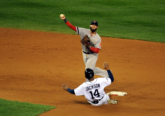 Oct 16, 2013; Detroit, MI, USA; Boston Red Sox second baseman Dustin Pedroia (15) forces out Detroit Tigers center fielder Austin Jackson (14) and throws to first base during the sixth inning in game four of the American League Championship Series baseball game at Comerica Park. Mandatory Credit: Tim Fuller-USA TODAY Sports