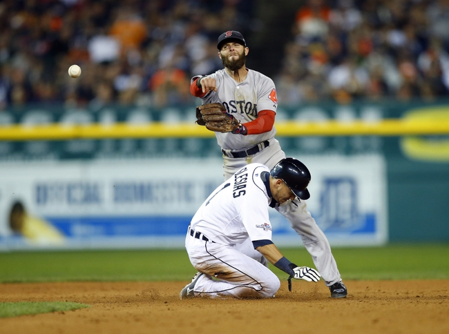 Boston Red Sox second baseman Dustin Pedroia (15) collides with Detroit Tigers shortstop Jose Iglesias (1) as he turns a double play during the sixth inning in game four of the American League Championship Series baseball game at Comerica Park. Mandatory Credit: Rick Osentoski-USA TODAY Sports