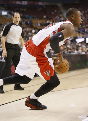 Oct 16, 2013; Toronto, Ontario, CAN; Toronto Raptors guard Terrence Ross (31) carries the ball against the Boston Celtics at Air Canada Centre. Toronto defeated Boston 99-97. Mandatory Credit: John E. Sokolowski-USA TODAY Sports